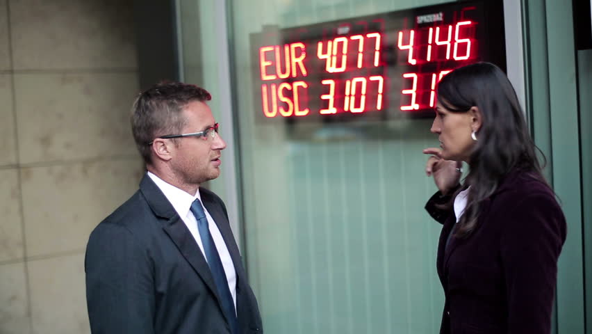 Business couple talking about financial market, steadicam shot