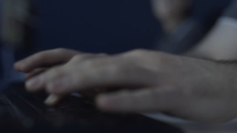 Close Up Of Ten Fingers Typing On Computer Keyboard In A Dark Room