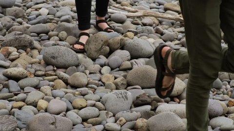 Friends Explore Rocky Shoreline On Oregon Coast, USA (Slow Motion Closeup)