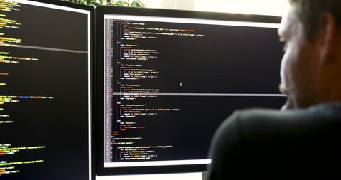 programmer working in office writing programming code (there is no possible trademark or copyright infringement with programming code)