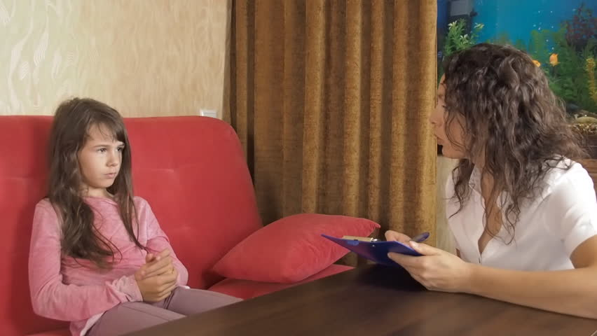 Sad child at the psychologist. The psychologist talks to the patient. | Shutterstock HD Video #29646148