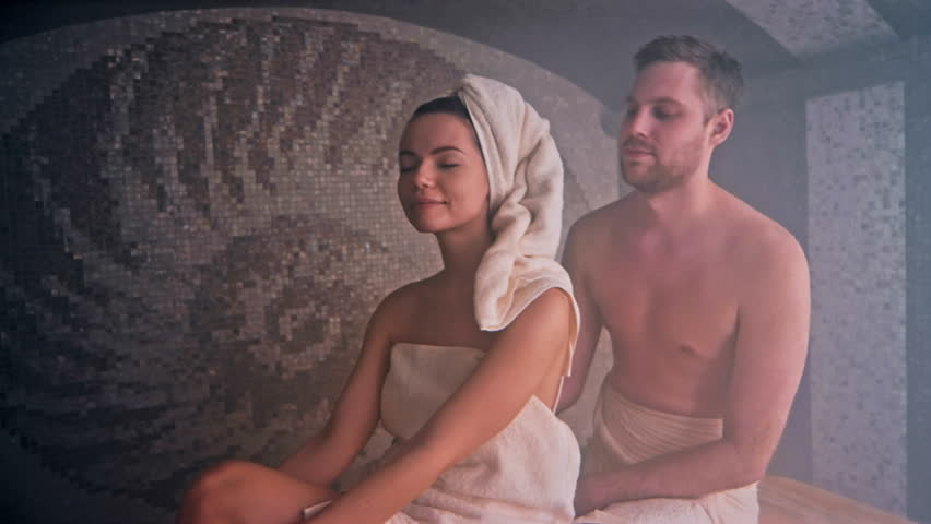 Relaxed young couple enjoying time in sauna. Shot in Red Epic Dragon