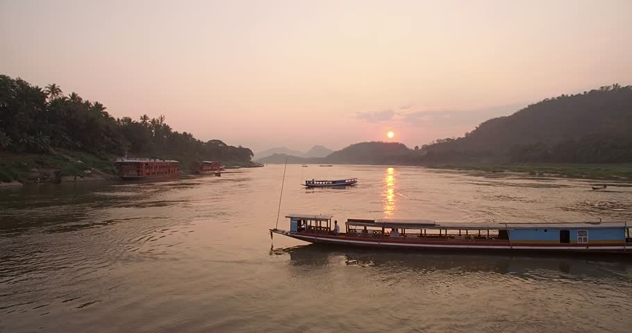 Tourist Cruise Boats on The Mekong River at Sunset, Luang Prabang, Laos, Aerial Shot