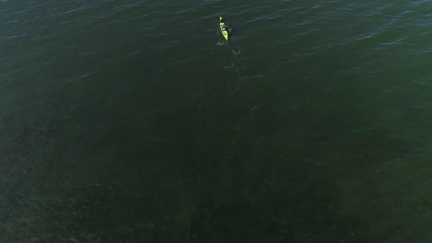Isolated Kayak Aerial of Man Paddling Endless Ocean Slow Motion