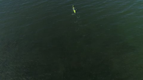 Isolated Kayak Aerial of Man Paddling Endless Ocean Slow Motion