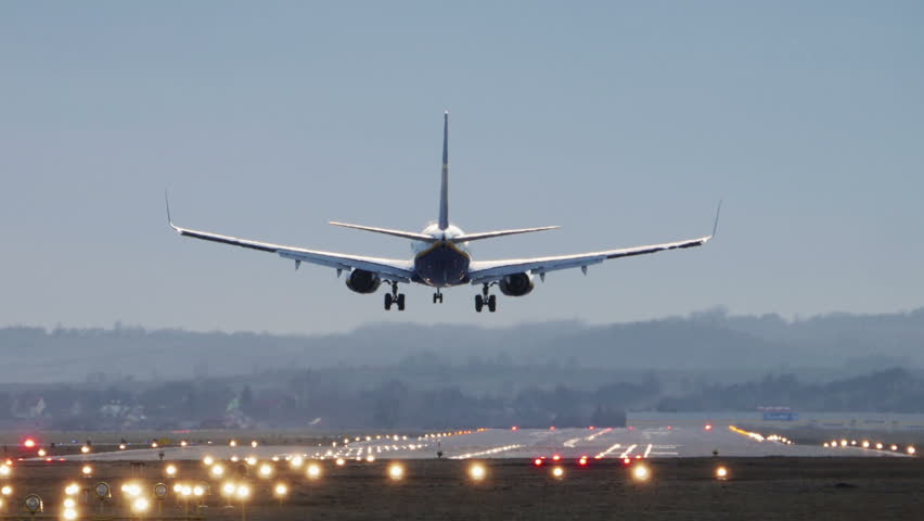 Commercial Jet Airplane Landing in airport runway in the morning. | Shutterstock HD Video #29693758