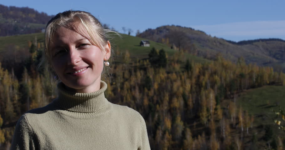 Closeup Of Attractive Blonde Woman Looking Camera Smiling In Summer Mountain Trip