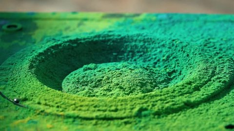 Loudspeaker throws colorful powder in the air, super slow motion shot