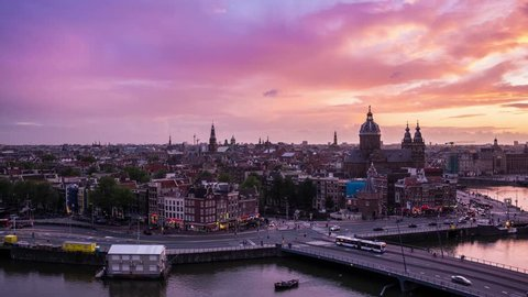 Beautiful 4K Timelapse day to night of Amsterdam skyline at sunset. The Netherlands, Europe.