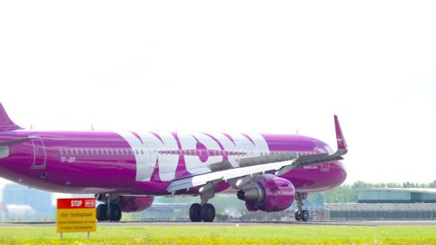 AMSTERDAM, THE NETHERLANDS - JULY 26, 2017: WOW Air Airbus 321 TF-JOY braking after landing on runway 18R Polderbaan. Schiphol Airport, Amsterdam, Holland