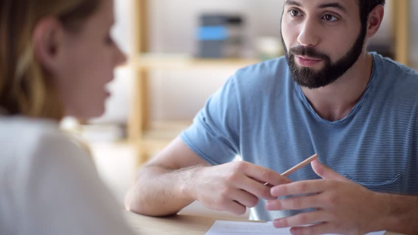 Positive young man sharing business ideas with female freelancer mate | Shutterstock HD Video #29755948