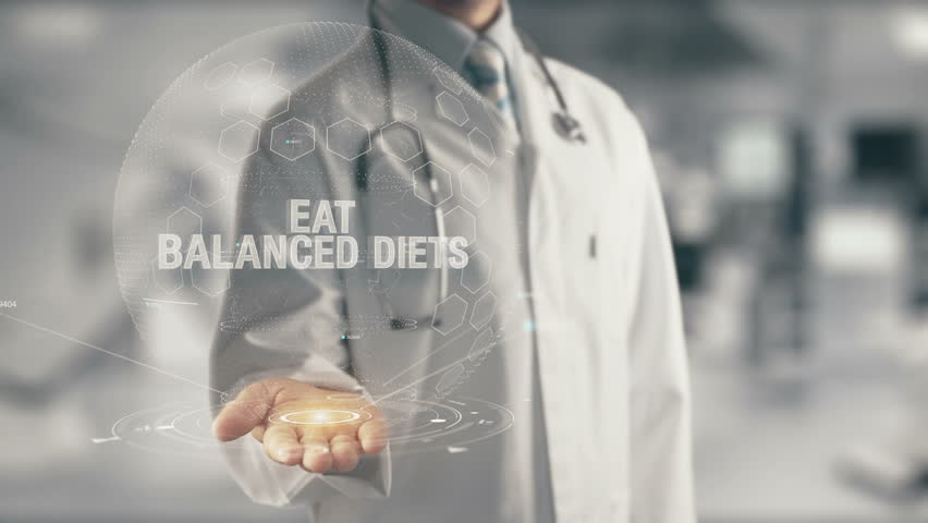Doctor holding in hand Eat Balanced Diets - 4K stock video clip