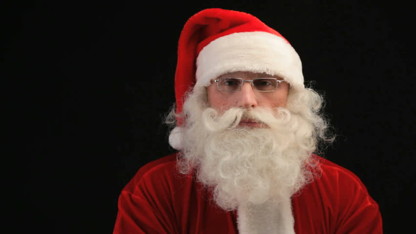 Close-up of Santa blowing snow, isolated against black background