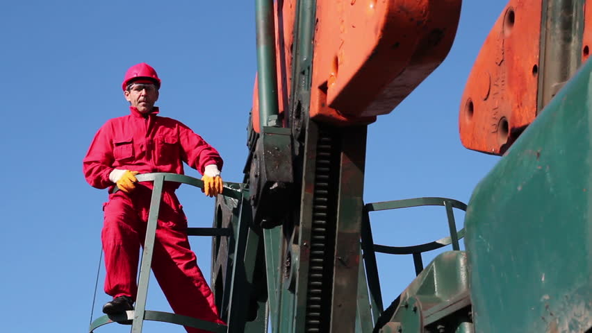 Oil Worker and Pump Jack.