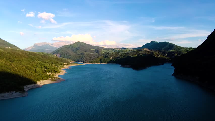 Reveal of blue mountain lake with glacier in background near Grenoble, France  | Shutterstock HD Video #29802298
