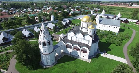 4K aerial video footage view of medieval Suzdal town and Kremlin, its churches, cathedrals, river Kamenka and area around it on summer day near Vladimir on Golden Ring route 240 km from Moscow, Russia