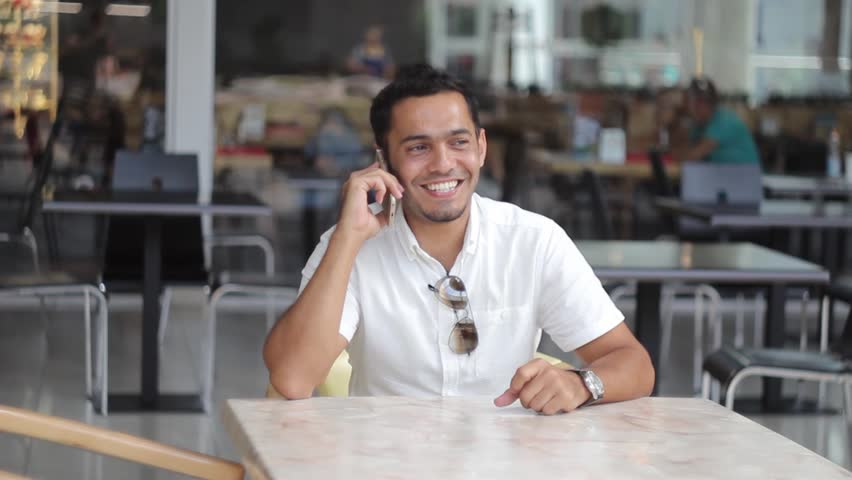 Happy dubai man talking on the phone and smiling | Shutterstock HD Video #29869078
