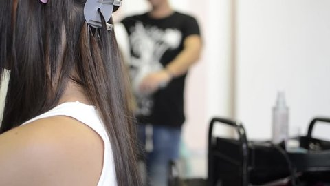 Hairdresser installs the upgrade of hair extension to the client in the salon, Hair extension with keratin concept and close up
