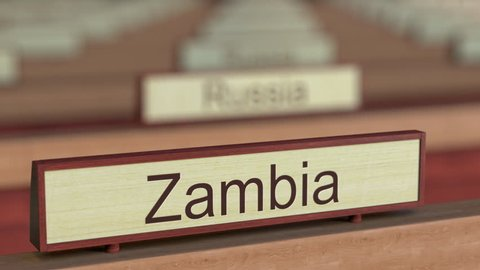 Zambia name sign among different countries plaques at international organization. 3D rendering