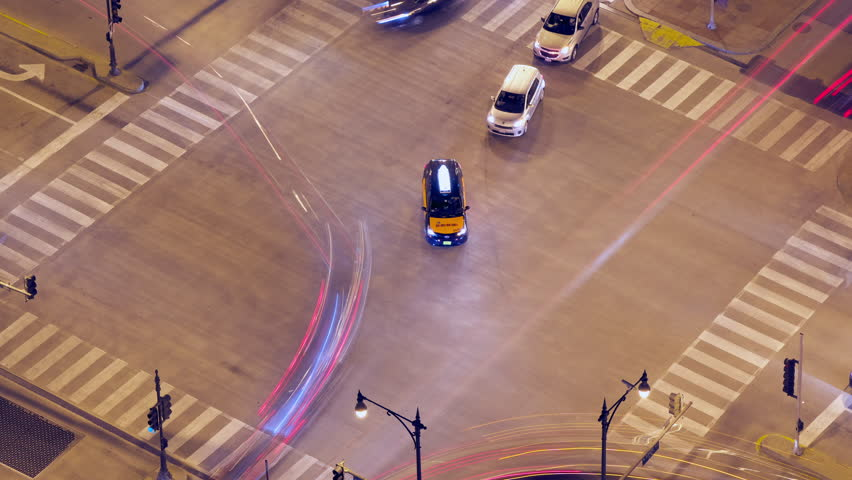 Night aerial view of cars in timelapse with long exposure creating long light line in Chicago