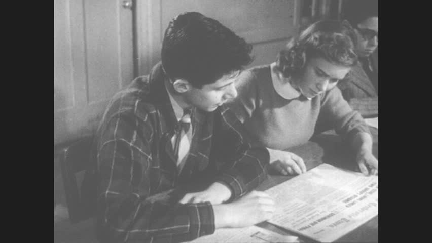 """1950s: Boy and girl read newspaper. Newspaper stories: one supporting building a playground, one opposing, """"Balanced Presentation"""" superimposed. Boy and girl read editorial supporting playground."""
