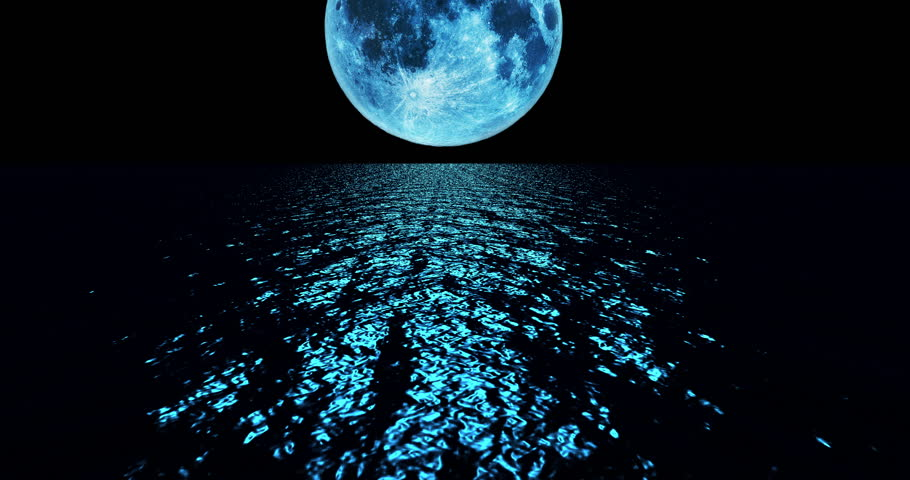 Blue colored moon setting slowly over the ocean at night. | Shutterstock HD Video #29934748