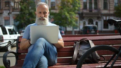Older greyhaired man enjoying working outside
