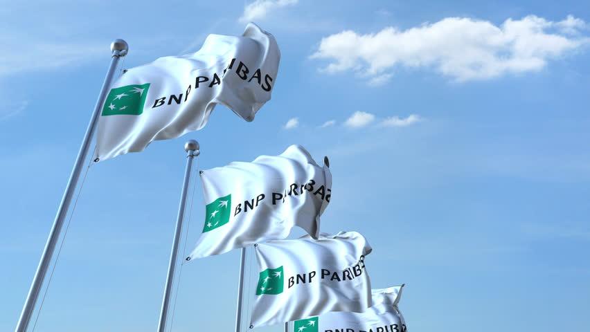 Waving flags with BNP Paribas logo against sky, seamless loop. 4K editorial animation