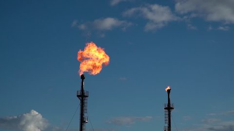 Huge oil torches. Slow motion.  Combustion of associated gas. Extraction and preparation of oil. Preparation of oil for transportation. Siberia