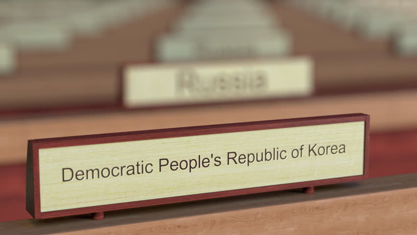 Democratic People's Republic of Korea DPRK name sign among different countries plaques at international organization. 3D rendering