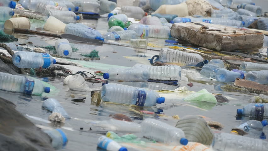 Environmental pollution. Plastic bottles, bags, trash in river, lake. Rubbish and pollution floating in water. Slow motion | Shutterstock HD Video #29954578