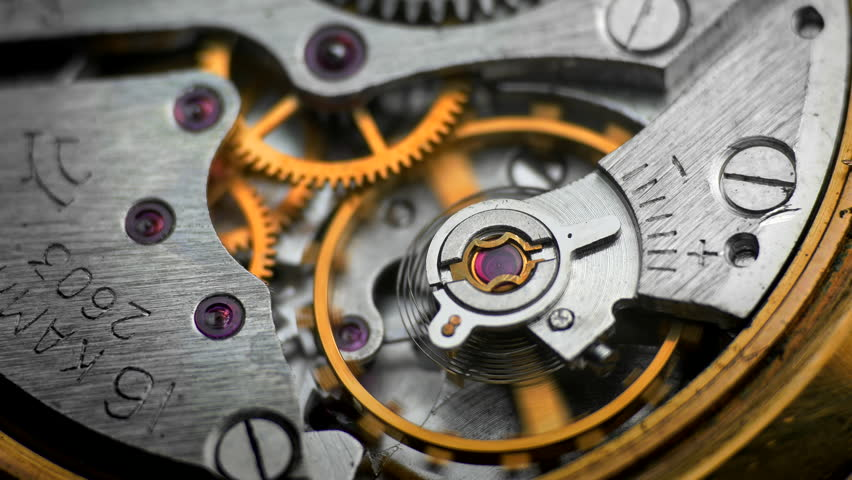 Time Keeping. Oscillating movement of an old mechanical wind up wristwatches. Macro close-up shot. (av26613c)