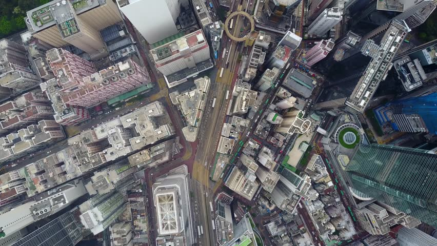 Fly along Yee Wo street, top-down aerial panorama of densely built Causeway Bay district at Hong Kong Island. Area crowded by tall towers and old houses. Densely packed urban cityscape pattern | Shutterstock HD Video #29970058