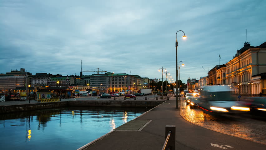 Helsinki, Finland. Embankment of port of Helsinki in Helsinki, Finland. Time-lapse of the pedestrian area with night traffic