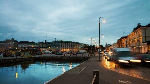 Helsinki, Finland. Embankment of port of Helsinki in Helsinki, Finland. Time-lapse of the pedestrian area with night traffic