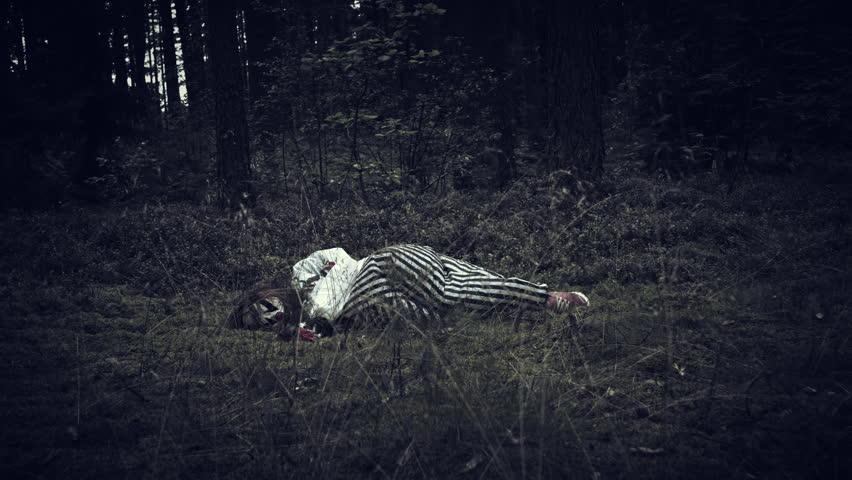 4K Halloween Horror Clown in Forest Waking Up