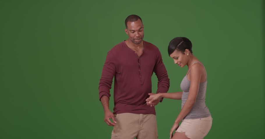 An African American couple dance on green screen. On green screen to be keyed or composited. #30022318