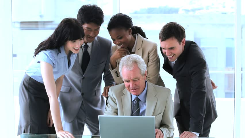 Smiling employees surrounding their manager in a bright room | Shutterstock HD Video #3002938