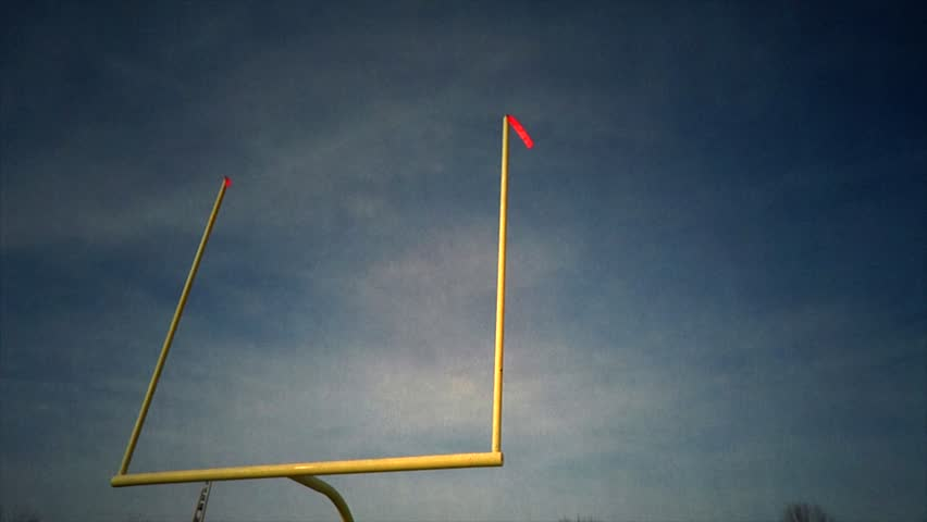 Football Goal Post - Time-lapse - A time-lapse of the football field goal post. The wind is blowing the flags as the clouds roll by.  | Shutterstock HD Video #3004252