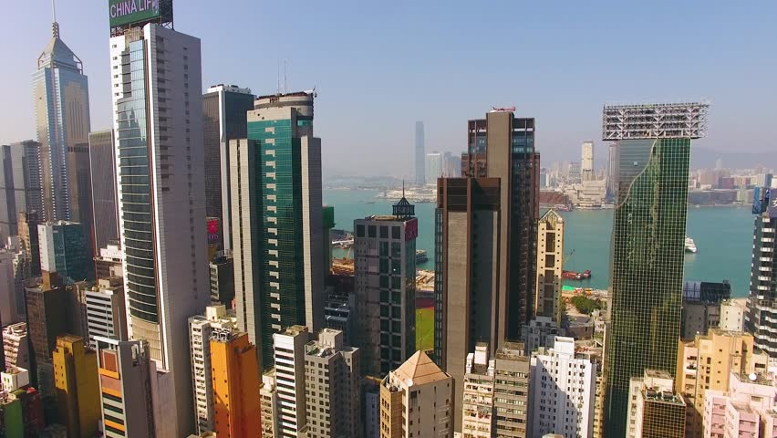 Hong Kong Aerial Drone is flying near skyscrapers Day 4k | Shutterstock HD Video #30043678