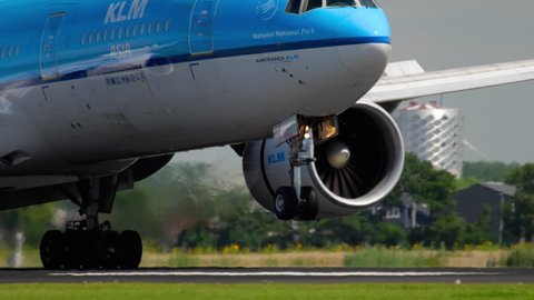 AMSTERDAM, THE NETHERLANDS - JULY 26, 2017: KLM Boeing 777 PH-BQN approaching and landing at runway 18R Polderbaan. Shiphol Airport, Amsterdam, Holland