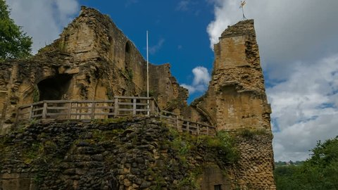 Telephoto panning shot of the Knaresborough Castle against a dramatic sky in Yorkshire, England, UK