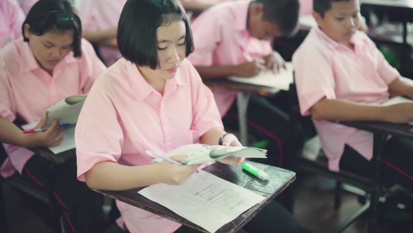 BANGPROK PATHUMTANI THAILAND AUGUST 2017 : Unidentified school girl take the exam on August 23 2017 in Bangprok Pathumtani Thailand. | Shutterstock HD Video #30064168