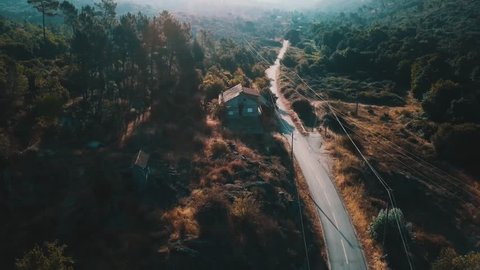 Cinematic Aerial Shot of an abandoned house during Sunrise in a rural area of South Europe, Northern Portugal in 4K