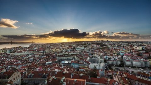 Amazing aerial sunset timelapse of sun rays over the Lisbon cityscape (Baixa district). Portugal. April, 2017