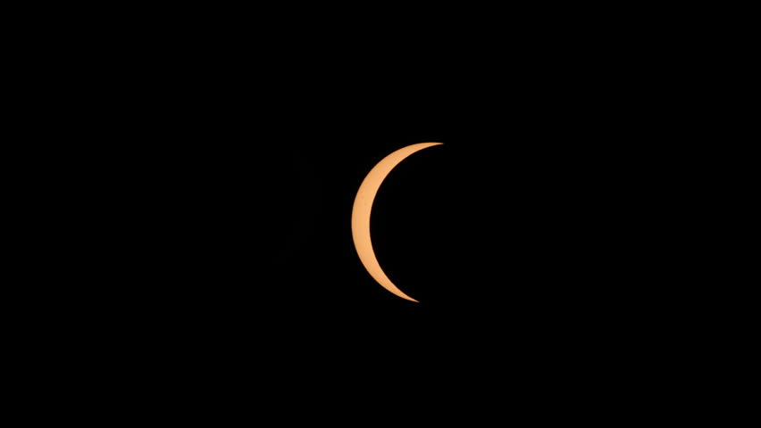 Only a crescent Sun remains in the first partial eclipse phase as the totality phase approaches during the Great American Eclipse on August 21, 2017.  Sunspots are visible on the sun's surface. #30076033