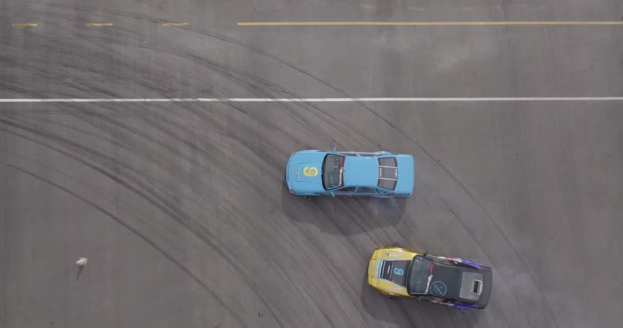 Top view of the car drifting on the race track.