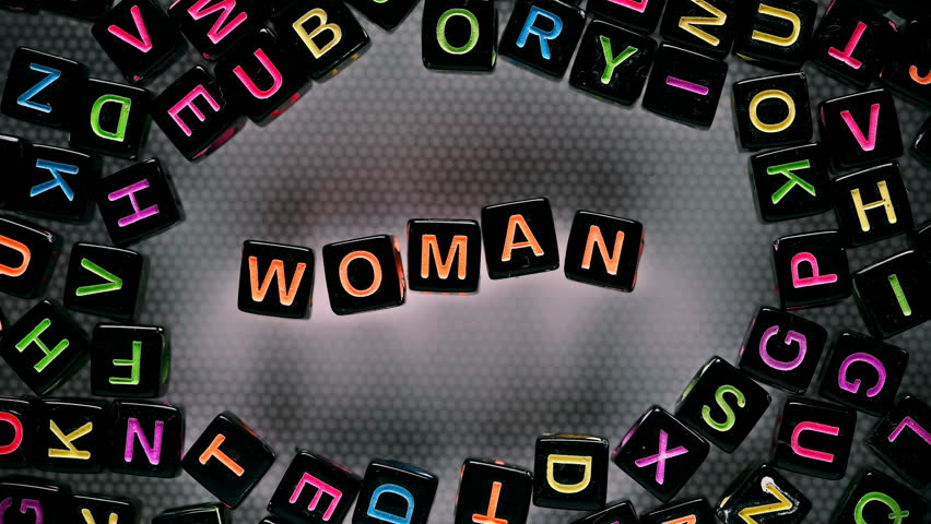 Cubes with letters collected word - woman | Shutterstock HD Video #30115270