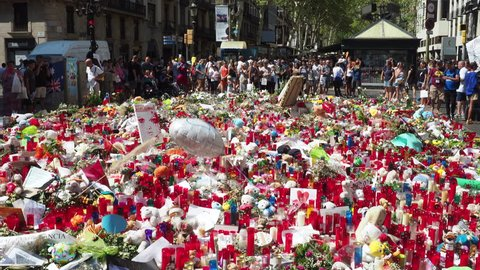 Barcelona, Spain - August 23, 2017: People visiting the Las Ramblas Memorial for the victims of the August 17, 2017 terrorist attack in Barcelona, Spain.