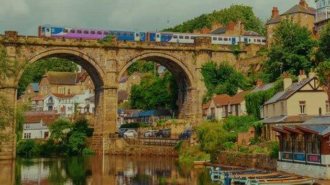 KNARESBOROUGH, August 2017 - Telephoto shot of a train crossing the Knaresborough railway viaduct over river Nidd in North Yorkshire, England, UK